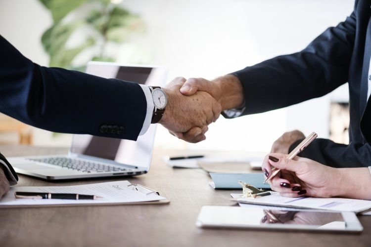 Businessmen shaking hands over a non disclosure agreement